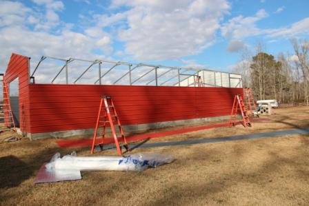 Barn going up, it is 24'W x 48'L x 9'H at the side walls and 12'H at the peak.
